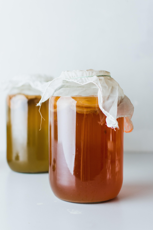 two kombucha jars as a natural remedy to gray hair